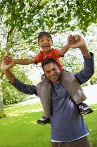Indian boy on fathers shoulders